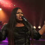 Tasha Cobbs sings during the first half of her live recording.